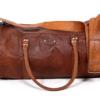 Brun læder taske - cylinder